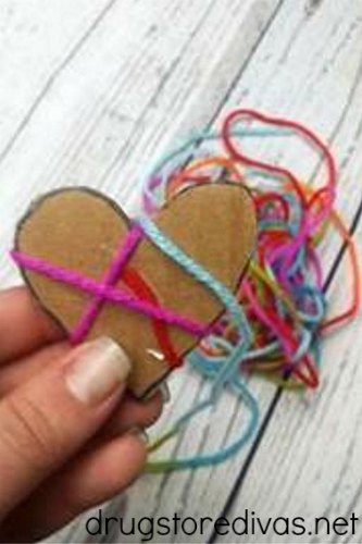 Need a Valentine's Day craft for kids? Check out these DIY Yarn Hearts from www.drugstoredivas.net.