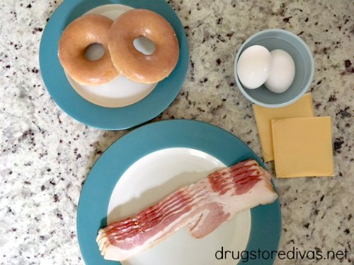 Looking for a perfect breakfast sandwich? Try this bacon, egg, and cheese doughnut breakfast sandwich from www.drugstoredivas.net.