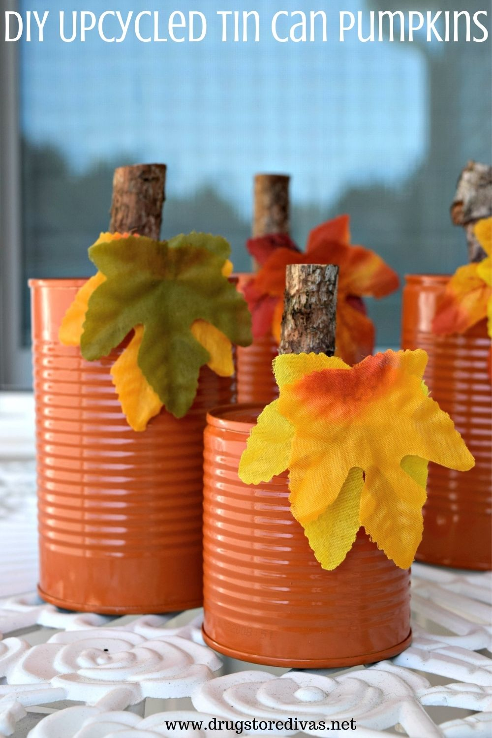 These DIY Upcycled Tin Can Pumpkins are super easy to make. And there's a good chance you have everything to make these rustic pumpkins at home already.